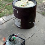 This is a 23 gallon lard kettle that I bought at a flea market last summer.  The stand was made by cutting an old fuel tank in half using a plasma cutter.  There is an 11 inch propane burner mounted under the kettle that provides the heat.